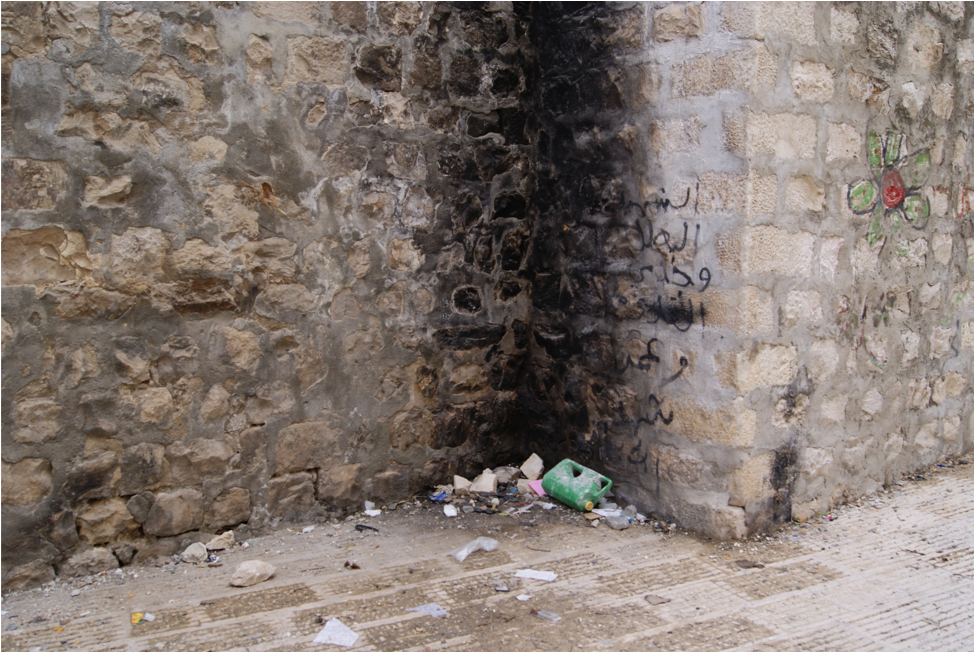 Trash burn corner in the Old City of Nablus, 2015. Photograph by the author.