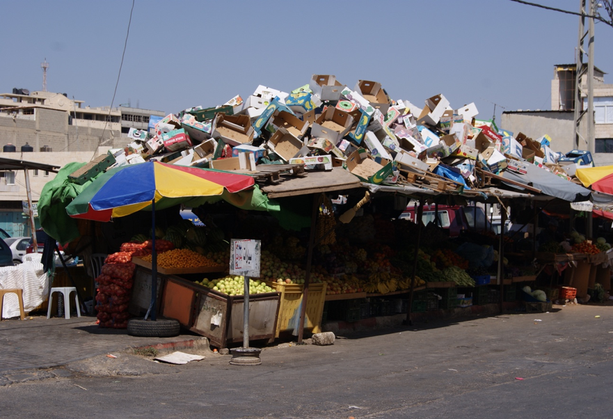 Used boxes sit atop a fruit and vegetable stand in Jenin, 2010. Photograph by the author.